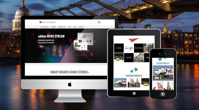 Professional Corporate Web Design for the NewsMarket, shown on three screens