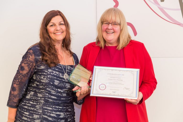 Christine receiving her award from Sandra Garlick